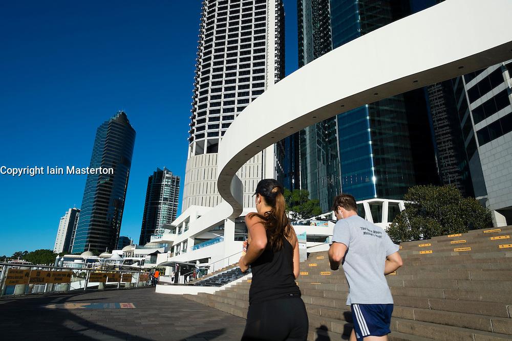 Modern high-rise buildings at Eagle Street Pier beside river in Brisbane CBD Queensland Australia