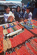 ECUADOR, MARKETS, CRAFTS Otavalo market woman and jewelry