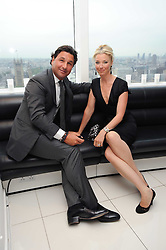 TAMARA BECKWITH and her husband GIORGIO VERONI at The Reuben Foundation and Virgin Unite Haiti Fundraising dinner held at Altitude 360 in Millbank Tower, London on 26th May 2010.