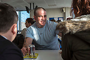 A prisoner chatting to  his children during  a visit at HMP/YOI Portland, Dorset, United Kingdom.