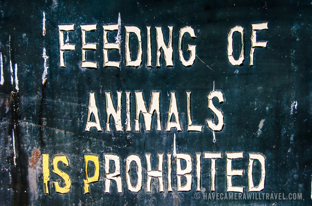 An old weathered sign warns against feeding the animals at Tarangire National Park in northern Tanzania not far from Ngorongoro Crater and the Serengeti.