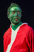 Armenian actor Arsen Badalian (C) disguised as Grinch plays the 1957 story 'How the Grinch Stole Christmas' at the State Institute of Theatre and Cinematography in Yerevan, Armenia on Sunday, Jan 3, 2021. <br /> The piece is written and illustrated by Dr Seuss, published as both a Random House book and in an issue of Redbook magazine. (Photo/ Vudi Xhymshiti)