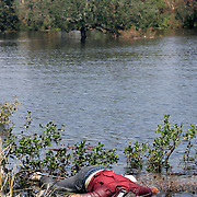 NEW ORLEANS, LA - September 4, 2005:  Search and rescue operations continue on Sept. 4, 2005 as fire fighters from Jefferson Parrish use a boat they borrowed to search for any last remaining survivors in need of evacuation. (Photo by Todd Bigelow/Aurora)....