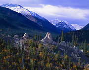 Hoodoos with peaks of the Terminal Range beyond, northern  Rocky Mountains, Muncho Lake Provincial Park, northern British Columbia, Canada.