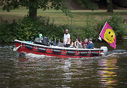 © Licensed to London News Pictures. 25/08/2016. Reading, UK. A river taxi transports music fans to Reading Festival on The Thames. Mixed weather is expected to greet the start of the three day music festival. Photo credit: Peter Macdiarmid/LNP