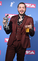 August 20, 2018 - New York City, New York, U.S. - Hip hop artist POST MALONE poses for photos in the press room for the 2018 MTV 'VMAS' held at Radio City Music Hall. (Credit Image: © Nancy Kaszerman via ZUMA Wire)