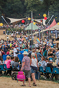 The Arena is packed but there is an eascape, punting or swimming on the lake - The 2018 Latitude Festival, Henham Park. Suffolk 13 July 2018
