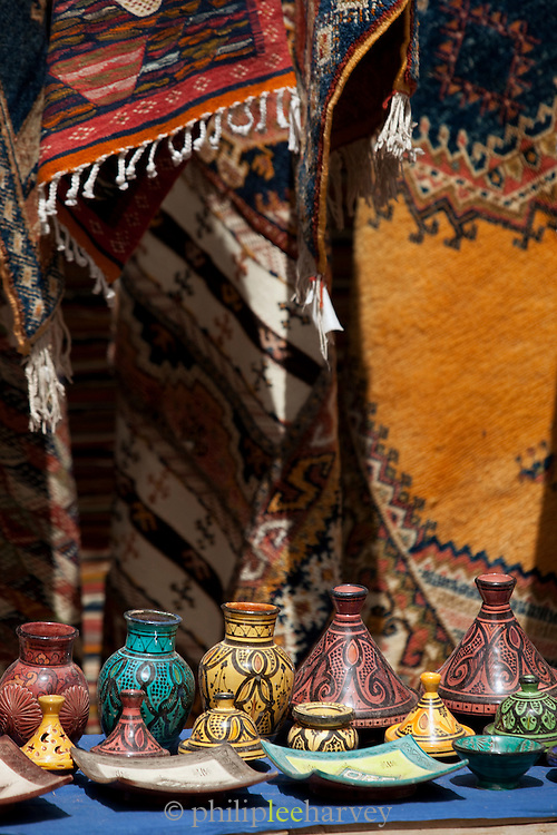 Small decorated pots for sale at a roadside stall in Morocco