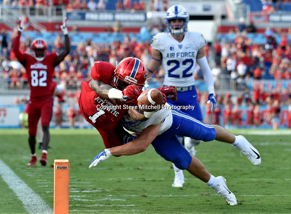 Sep 8, 2018; Boca Raton, FL, USA; Florida Atlantic Owls wide receiver Willie Wright (1) dives over the pylon for a touchdown as Air Force Falcons defensive back Jeremy Fejedelem (2) defends the play during the second half at FAU Football Stadium. Mandatory Credit: Steve Mitchell