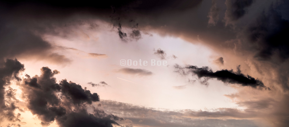 panoramic opening up of clouds after a rain storm