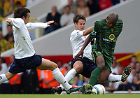 Photo. Daniel Hambury.<br /> The Barclays Premiership.<br /> <br /> Tottenham Hotspur V Norwich. 12/9/2004.<br /> <br /> Tottenham' Hotspurs Simon Davies and Jamie Redknapp combine to stop Norwich's Damien Francis. Redknapp was booked<br /> <br /> NORWAY ONLY