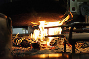 traditional wood fire under old iron pot