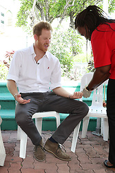 Prince Harry takes part in a live HIV test, at the 'Man Aware' event held by the Barbados National HIV/AIDS Commission in Bridgetown, Barbados, during his tour of the Caribbean.