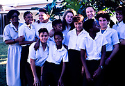 Group of teenager high school students with their teacher, Cayman Brac, Cayman Islands, West Indies c 1990