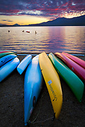 Kayaks on the shoreline of Lake Quinault in Washington state's Olympic National Park
