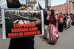 September 6, 2017 - Medan, North Sumatra, Indonesia - Muslim women held posters during a demonstration rally against the Rohingya minor persecution in Medan. Indonesian Muslims held angry demonstrations against the persecution and condemned the worsening humanitarian situation in Rakhine state, also called on the Indonesian government to take a tougher stance against it for an end to violence against the Rohingya Muslim minority in the country. (Credit Image: © Ivan Damanik via ZUMA Wire)