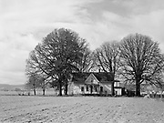 9969-5360. Old farm home near Verboort, Oregon. February 10, 1942. Now called the Beeks house, oldest in Washington County, and one of the few buildings left standing from the original 4,600 Donation Land Claims issued in the Willamete Valley in the 1850s. Its named after the original owners, Silas and Mary Beeks, who built it after they arrived in 1847.