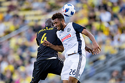 May 9, 2018 - Columbus, OH, U.S. - COLUMBUS, OH - MAY 09: Columbus Crew defender Jonathan Mensah (4) and Philadelphia Union defender Auston Trusty (26) meet to head the ball as in the MLS regular season game between the Columbus Crew SC and the Philadelphia Union on May 09, 2018 at Mapfre Stadium in Columbus, OH. (Photo by Adam Lacy/Icon Sportswire) (Credit Image: © Adam Lacy/Icon SMI via ZUMA Press)
