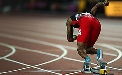 London, 2017-August-04. A sprinter's explosive power is demonstrated as he leaves his starting blocks at the IAAF World Championships London 2017. Paul Davey.