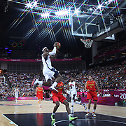 Lebron James, USA, slam dunks during the Men's Basketball Final between USA and Spain at the North Greenwich Arena during the London 2012 Olympic games. London, UK. 12th August 2012. Photo Tim Clayton