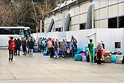 Nederland, Nijmegen, 3-3-2016Kamp Heumensoord. De noodopvang van 3000 asielzoekers loopt langzaam leeg en moet op 1 juni door het coa overgedragen zijn aan de gemeente. De vluchtelingen vertrekken vanaf hier naar andere opvanglocaties. Zowel per bus als op individuele basis kan men naar het volgende AZC. Deze bus gaat naar Blauwestad in Groningen. Hiermee komt een eind aan de grootschalige opvang die in deze vorm niet snel zal terugkeren.FOTO: FLIP FRANSSEN