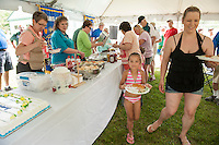 Megan Gibson and her daughter Aubrielle enjoy a complimentary BBQ following the 70th Anniversary celebration of the Kiwanis Pool in St. Johnsbury Vermont.  Karen Bobotas / for Kiwanis International