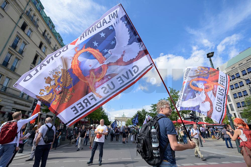 """29 AUG 2020, BERLIN/GERMANY:<br /> Mann mit QAnon-Flagge, mit der Aufschrift """"Wladimir Donald Give us free"""", Demonstration gegen die Einschraenkungen in der Corona-Pandemie durch die Initiative """"Querdenken 711"""" aus Stuttgart unter dem Motto """"invites Europa - Fest für Freiheit und Frieden"""", Unter den Linden<br /> IMAGE: 20200829-01-035<br /> KEYWORDS: Demo, Protest, Demosntranten, Protester, COVID-19, Corona-Demo, Brandenburger tor"""