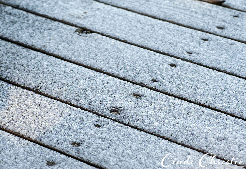 Evidence of a light overnight snow remains on a boat dock in South Lake Tahoe, Calif., on Tuesday, April 26, 2011. Stormy winter weather damaged the dock and it is not known if the structure will be removed or repaired. Many business owners hope warmer weather will bring an abundance of tourists.  (© 2011 Cindi Christie/Cyanpixel® Photography)