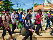 05 JULY 2017 - POIPET, CAMBODIA: Cambodian migrant workers in Poipet, Cambodia, walk to the Thai-Cambodia border. The Thai government proposed new rules for foreign workers recently. The new rules include fines of between 400,000 and 800,00 Thai Baht ($12,000 - $24,000 US) and jail sentences of up to five years for illegal workers and people who hire illegal workers. Hundreds of companies fired their Cambodian and Burmese workers and tens of thousands of workers left Thailand to return to their countries of origin. Employers and human rights activists complained about the severity of the punishment and sudden implementation of the rules. On Tuesday, 4 July, the Thai government suspended the new rules for 180 days and the Cambodian and Myanmar governments urged their citizens to stay in Thailand, but the exodus of workers continued through Wednesday.     PHOTO BY JACK KURTZ