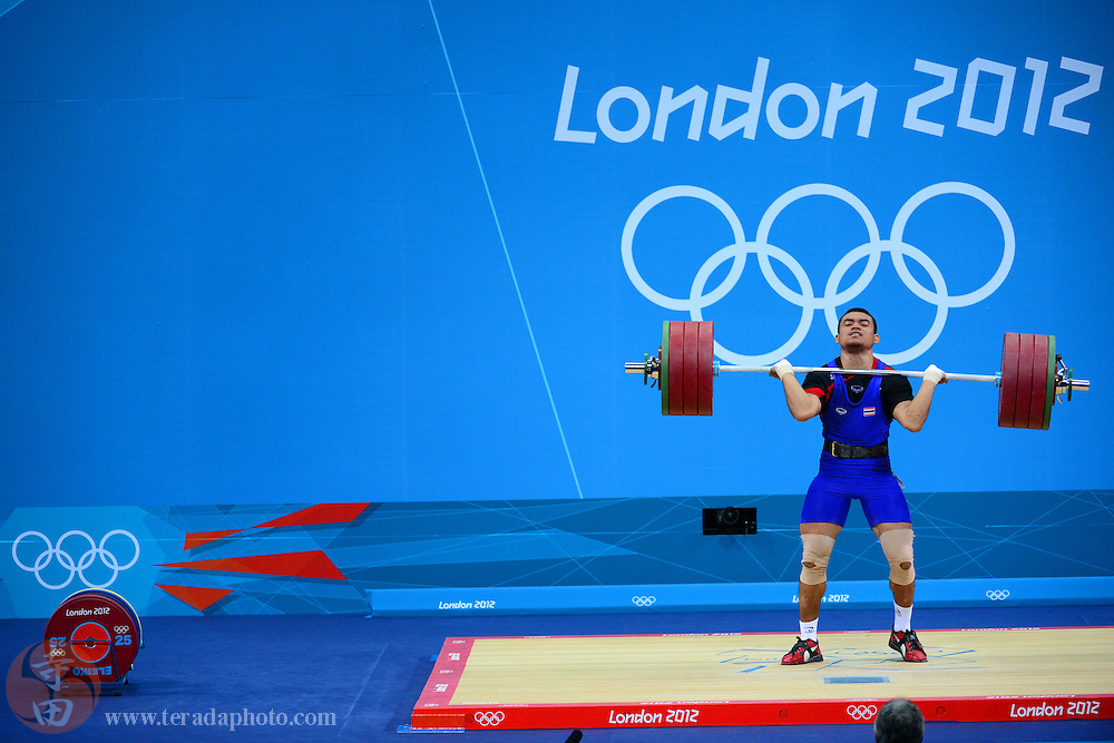 Aug 3, 2012; London, United Kingdom; Pitaya Tibnoke (THA) competes in the weightlifting men's 85kg group B during the London 2012 Olympic Games at ExCeL - South Arena 3.