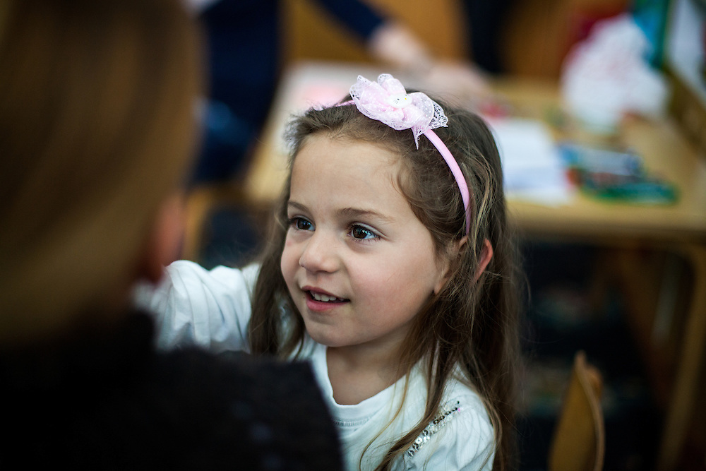 The daughter of one of the participants at Romina's workshop related to Roma health issues in a kindergarden located in the city of Vinica in Macedonia during the European Immunization Week. Almost all attending women are from the local Roma community.