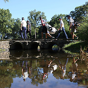 Jason Day, Australia, Jordan Spieth, and Bubba Watson,  USA, cross a bridge on the 14th hole with their caddies during an early morning start at The Barclays Golf Tournament at The Plainfield Country Club, Edison, New Jersey, USA. 27th August 2015. Photo Tim Clayton