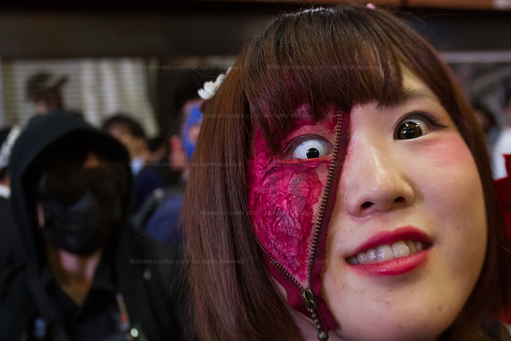 Extreme make up effects during the Halloween celebrations Shibuya, Tokyo, Japan. Saturday October 27th 2018. The celebrations marking this event have grown in popularity in Japan recently. Enjoyed mostly by young adults who like to dress up, drink , dance and misbehave in parts of Tokyo like Shibuya and Roppongi. There has been a push back from Japanese society and the police to try to limit the bad behaviour.