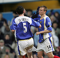 Photo: Lee Earle.<br /> Portsmouth v Manchester United. The Barclays Premiership. 11/02/2006. Portsmouth's Matthew Taylor (R) is congratulated after scoring their goal.