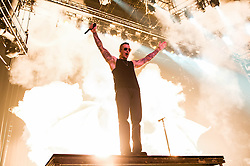 © Licensed to London News Pictures. 01/12/2013. London, UK.   Avenged Sevenfold performing live at Wembley Arena. In this pic - M.Shadows.The band is also known as A7X and consists of members M. Shadows (lead vocals), Zacky Vengeance (rhythm guitar/vocals),  Synyster Gates (lead guitar/vocals),Johnny Christ (bass) and Arin Ilejay (drums).  Photo credit : Richard Isaac/LNP