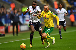 Bolton Wanderers' Sammy Ameobi (left) and Norwich City's Tom Trybull in action