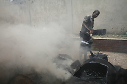 May 10, 2017 - Dhaka, Bangladesh - A man boils bitumen which is used for the production of tarmac for the road construction in Dhaka, Bangladesh, May 10, 2017. (Credit Image: © Suvra Kanti Das via ZUMA Wire)