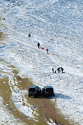 © Licensed to London News Pictures. 16/02/2016. Hay Bluff - Brecon Beacons National Park, Powys, Wales, UK. Families arrive in 4WD vehiclesat to go toboggannind at Gospel Pass, Hay Bluff - near Hay-on-Wye - in the Eastern sector of the Brecon Beacons (The Black Mountains) in Powys, Wales, UK. Snow which fell a week ago still lies on the summits of the Brecon Beacons. Temperatures this morning are several degrees centigrade below zero but with the moderate wind the 'feels like' temperature is around minus 5 - 8 degrees centigrade. Photo credit: Graham M. Lawrence/LNP