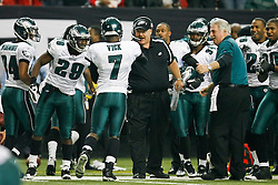 Philadelphia Eagles Head Coach Andy Reid congratulates quarterback Michael Vick #7 after Vick scored a touchdown during the NFL game between the Philadelphia Eagles and the Atlanta Falcons on December 6th 2009. The Eagles won 34-7 at The Georgia Dome in Atlanta, Georgia. (Photo By Brian Garfinkel)