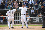CHICAGO - SEPTEMBER 17:  A.J. Pierzynski #12 greets Dayan Viciedo #24 of the Chicago White Sox after Viciedo hit a home run against the Detroit Tigers on September 17, 2012 at U.S. Cellular Field in Chicago, Illinois.  The White Sox defeated the Tigers 5-4.  ((Photo by Ron Vesely)  Subject:  A.J. Pierzynski; Dayan Viciedo
