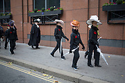 Girls wearing old fashioned bonnets. The Lord Mayor's Show, one of the longest-established annual events, dating back to the 16th century. Held within the City of London, UK.