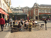 A51P98 Eating outside in Covent Garden London England