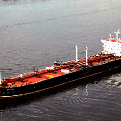 Aerial photograph of the Athos I Tanker, on the Delaware RIver after heavy crude oil spill outside the Citgo asphalt refinery Plant in Paulsboro, NJ   between Philadelphia, New Jersey & Delaware.  Showing cleanup efforts.