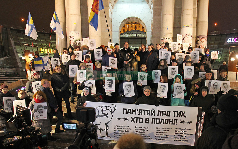 December 17, 2018 - Kiev, Kiev, Ukraine - Protesters are seen holding a banner and portraits of Ukrainians captured and imprisoned by Russians during the  rally..Ukrainians held the rally in support of the 24 Ukrainian navy sailors who were seized by the Russians during the Kerch Strait incident on 25 November 2018, and other Ukrainian political prisoners in Russia, Crime and the conflict zone of the East of Ukraine. On November 26 Ukrainian Parliament voted for accepting of the state of martial law for 30 days in 10 regions that border Russia, the Black Sea and the Azov Sea. (Credit Image: © Pavlo Gonchar/SOPA Images via ZUMA Wire)