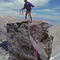 Andy Selters sets up a tricky Tyrolean Traverse on the Sun Ribbon Arete of Temple Crag in the Palisade region of California's Sierra Nevada.