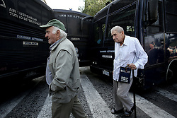 October 3, 2016 - Athens, Greece - Pensioners march in front of police buses that closes the street to the government's headquarters. In Athens, on Monday October 3, 2016. Greek pensioners taking part at a protest march against pension cuts, demanted meeting with Prime minister but were stoped with tear gas by riot police close to Maximos mansion, the government's headquarters. (Credit Image: © Panayiotis Tzamaros/NurPhoto via ZUMA Press)