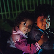 Night, Sunday 13th of September 2015. I met Aysha outside the entrance of the registration camp in Preshevo, about two hours after we parted in the Macedonian-Serbian border. Her belly was swollen and she was bleeding. A Serbian officer took her to the hospital, she asked me to go and find the girls at the queue and look after them. The girls were happy to see me.
