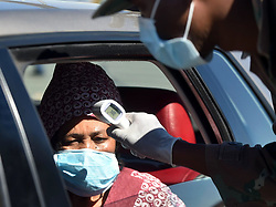 South Africa - Johannesburg - 03 May 2020 -Gauteng community safety MECFaith Mazibukoalong withlaw enforcement officers and Health officials, conduct Covid-19 screening and testing on the N1 South provincial border for all motorists and passengers who are coming back to Gauteng Province.Picture: Itumeleng English/African News Agency(ANA)
