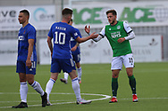 Cove Rangers Jamie Masson (10) and Jamie Gullan (19) of Hibernian shake hands after the Betfred Scottish League Cup match between Cove Rangers and Hibernian at Balmoral Stadium, Aberdeen, Scotland on 10 October 2020.