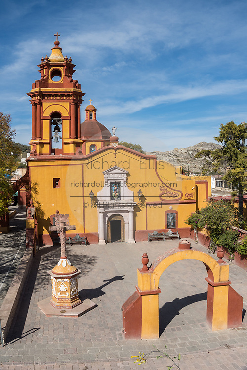 The Parroquia San Sebastian church in the beautiful colonial village of Bernal, Queretaro, Mexico. Bernal is a quaint colonial town known for the Pena de Bernal, a giant monolith which dominates the tiny village is the third highest on the planet.